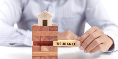 wooden block concept of homeowners Insurance