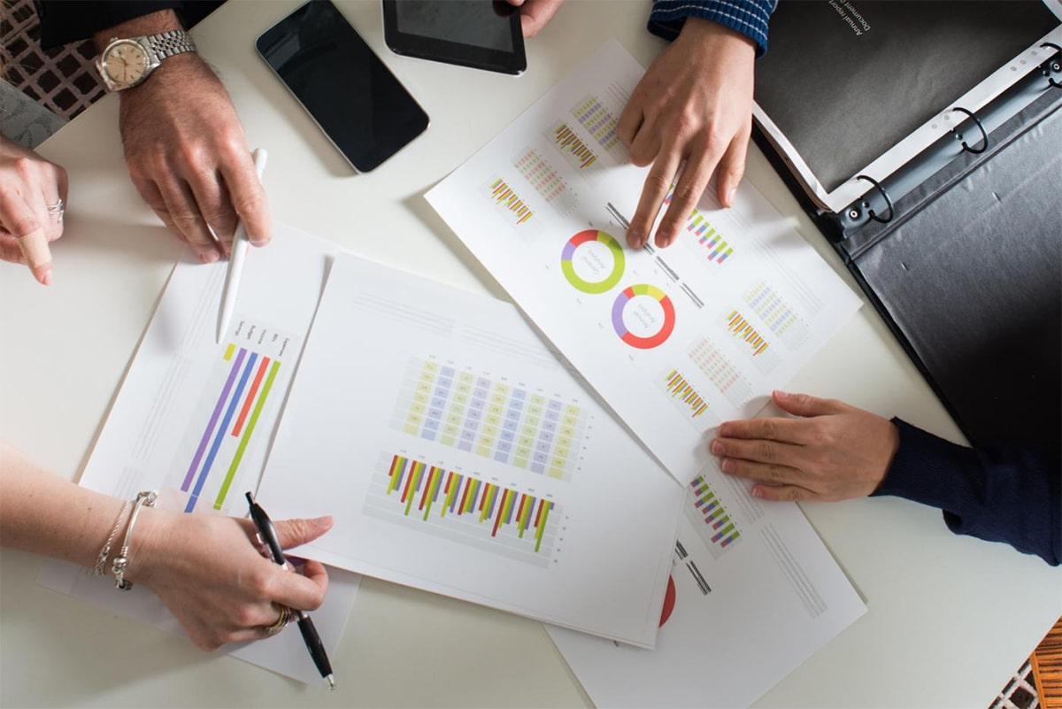 Traders and printed charts on the table