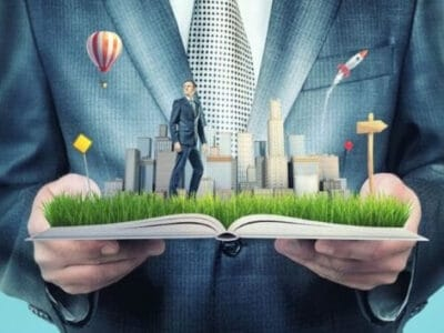 little businessman and city on the book`s pages